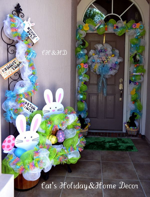 Easter Basket Door Decor. This well-refined Easter decor starts with mesh in white and lime green, add the ribbons as the base. Put two baskets filled with treats for children at two sides such as chocolate bunnies, rolled candy, Easter eggs and jelly beans.