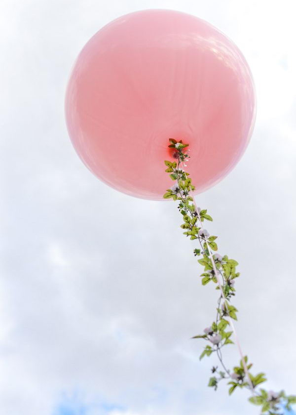 Pink Balloon Spring Decoration. What makes this eye-catching is the floral garlands adding to the large-sized pink balloon. Try this creative Easter decoration idea to add some spring flavor, it's so wonderful!
