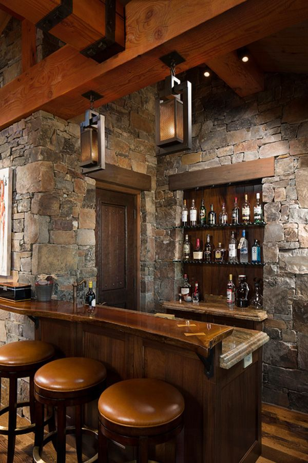 Rustic home bar design. The home bar has become one of the typical rooms in homes today. Rich wood, leather chairs,stone wall are popular in the modern-day life.