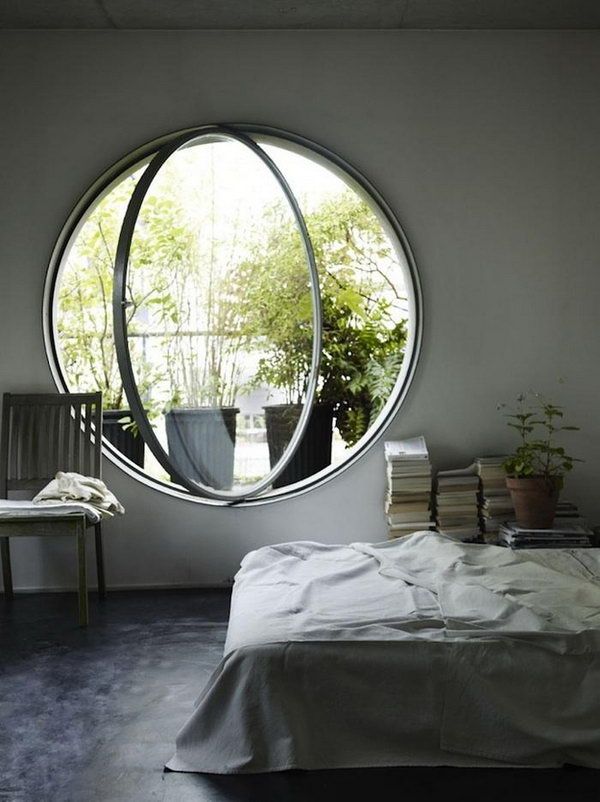 Huge round bedroom window. A huge round window in your bedroom make your sunbath dream come true. And the beautiful scene out of the window keep you in a good mood.