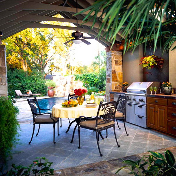 Outdoor dining room. A poolside dining space with a ceiling fan gets the air moving, keeps the kitchen cool and ensures the outdoor party continues all day long.