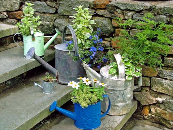 The old watering can could be turned into some plant pots.