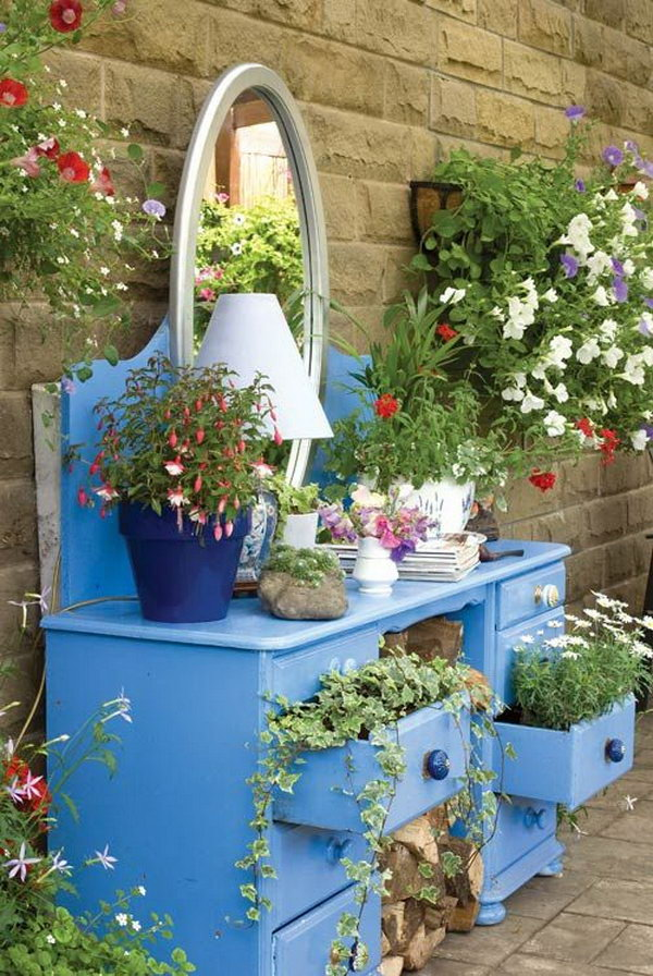 If you have an old dresser, do not just throw it away. You can give it a second life to create a multi-level flower bed. Another way, you can also use it to stage pots stones and gardening tools on the top for added interests to make your garden organized and decorate your yard.