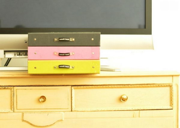 Useful Boxes to Keep Things Organized. Invest affordable storage containers to avoid the mess caused by DVDs, CDs and paperwork for electronics. A simple storage container can turn your room decor into a tidy and clean style.