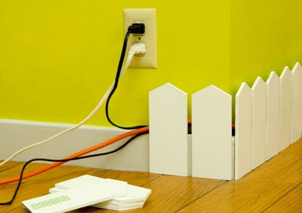 Mini Picket Fence. Use this electronic cable-organizing solution with this mini wall picket fence to serve your brilliant home decor for electronics.
