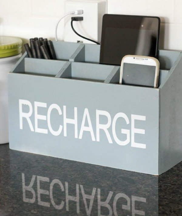 DIY Charging Station. Cut wooden boards, put them together and use nails to fasten them, spray white enamel on the charging station. It's fantastic to put all your gadgets in the counter without looking like clutter.