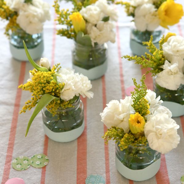 Dip the Jars in Paint. Dip the jar into the bowl filled with paint. Fill with flowers or tea lights to make beautiful decor for your celebration when they are dry.