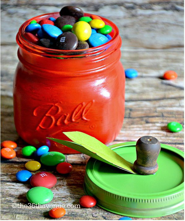 DIY Apple Jars. Get ready to paint the jar in red and ring lid in green. Add stem from wooden peg and green leaves from cardstock. With easy processes, you can turn out an amazing piece of art.