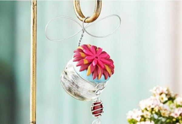 Hummingbird Feeder. Paint the lid of the jar, glue plastic flowers for beautiful decor at the top. Hang it around the hook. Replace your out of date hummingbird feeder with this exquisite one for practical use as well as beautiful decor.