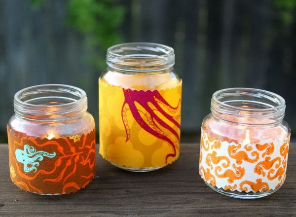 Fabric Baby Jar Votives. Transform your plain jar into an exquisite one by wrapping up the jar with beautiful patterned fabric. Place candles to finish off this adorable well-refined work of art.