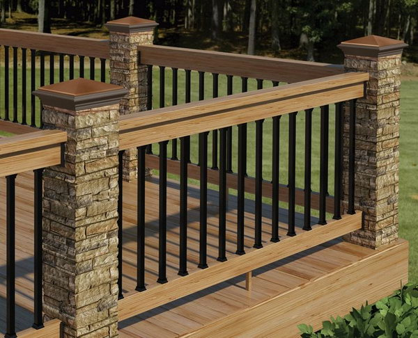 Stone, metal and wood deck railing. This deck railing has a wooden top with horizontal metal rails and big stone pillars and it's very sturdy and low maintenance . The color theme coordinates perfectly with the composite decking. What an attractive, warm and inviting outdoor living space.
