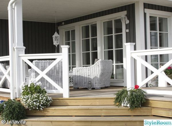 Natural color deck and the white X-shape railing. Stylish X-shape decorations become more and more popular these days. Awesome white X-shape rails add to a delicate custom look to the natural color deck.