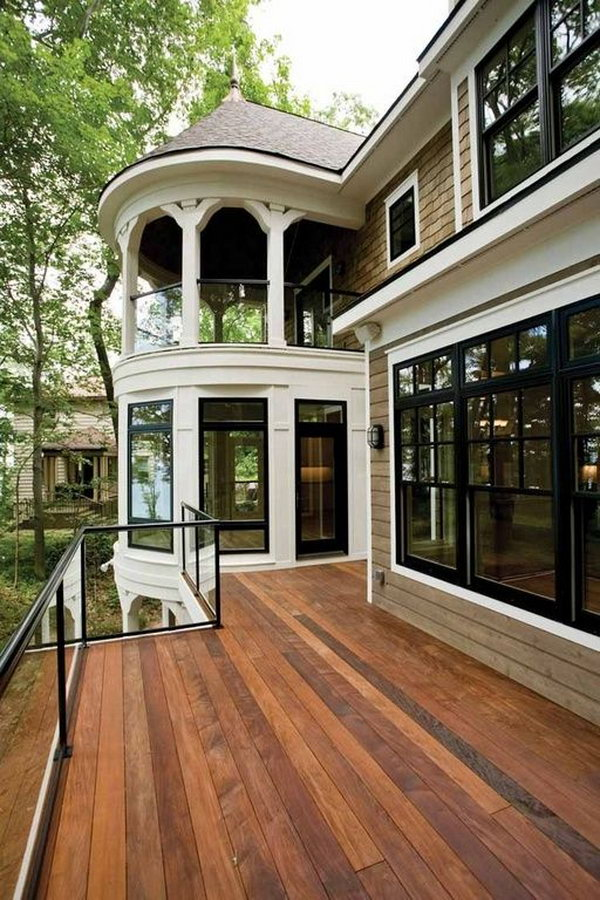 Stay beautiful - Traditional deck with glass deck railing. Adorable gazebo glass system coordinates perfectly with the French doors, double-hung windows and the deck.  The glasses allows unobstructed views and they are barriers against the wind.
