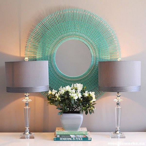 DIY Aquamarine Sunburst mirror. This is another idea about DIY mirrored wall art. You can create different ones with beads in any color as you like.