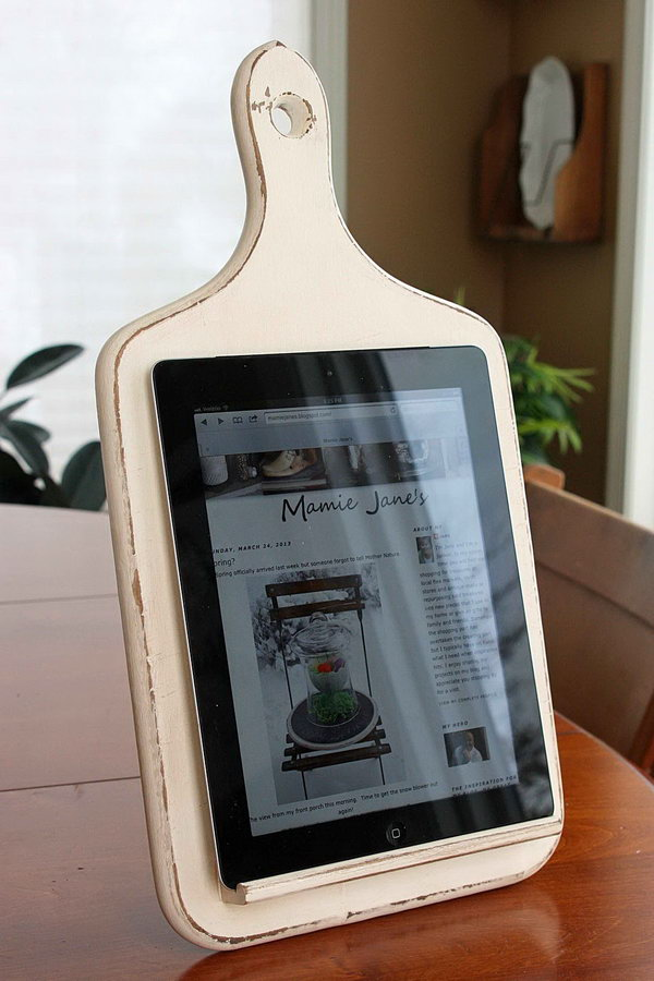 DIY kitchen iPad stand.This cool iPad holder is made from an old wooden kitchen board.It's convenient for you to follow recipes online when cooking.