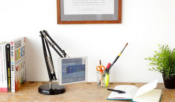DIY iPad stand from a lamp. With little imagination, this awesome iPad stand is made from an old lamp. You need another important material, Sugru, the amazing, stick-to-anything rubber glue so that your iPad stand turns into a strong flexible.