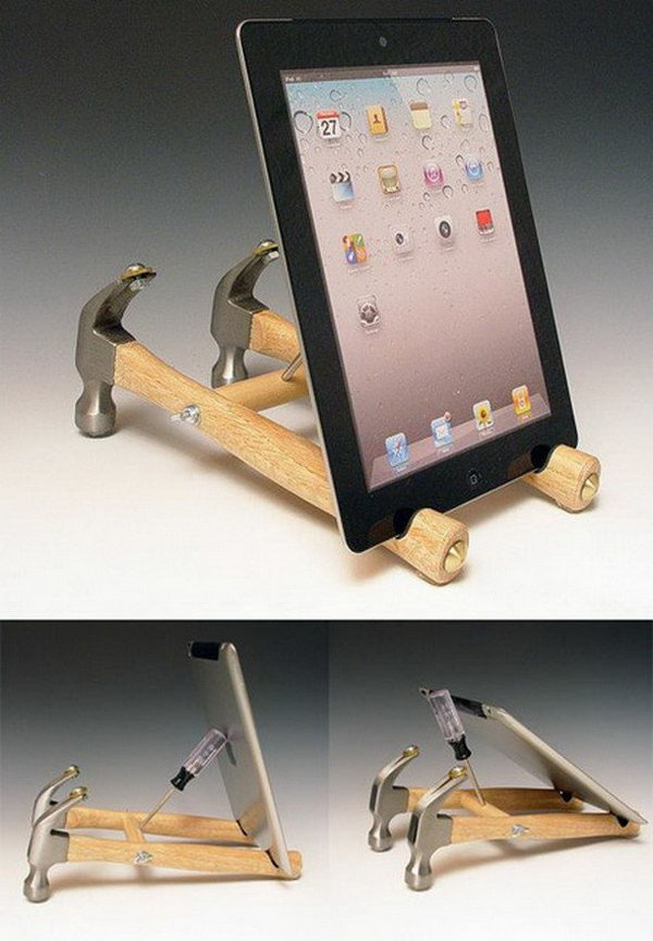 DIY hammer iPad stand. This is probably the most amazing, and yet the least practical iPad stand I've ever seen. It is made from a pair of hammers, a screwdriver and some old coins and bolts.