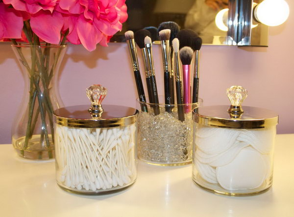 DIY makeup brush holders from empty candle jars. What a super easy project for your makeup storage.