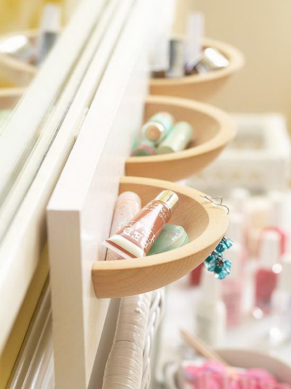 Use the wooden bowls bought from a dollar store cut in half and painted boards  to make these cute and beautiful wall pockets as  makeup storages. Of course, the size of the wall is up to you.