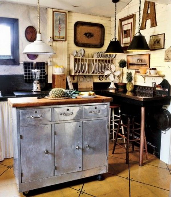 Try a steel island. This steel island is pretty adorable. To break up a sea of white or wood cabinets, refacing some of your cabinets or the island with metal would be a great option to keep the room from feeling boring.