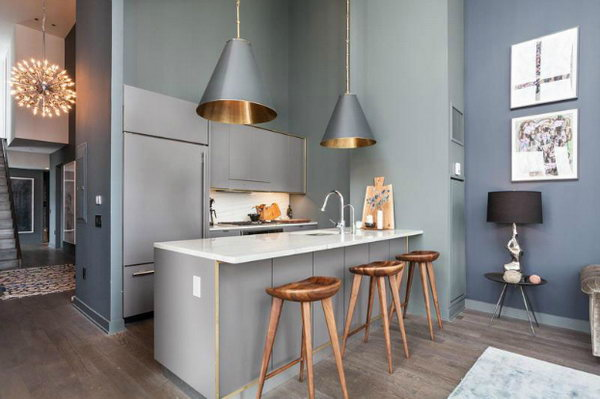 Industrial kitchen with Trendy Glamour. This stylish  smoke grey kitchen has a trendy and attractive outlook. I love every detail of this kitchen, the pendants, the wall paint, the wall art, the custom stools and all.