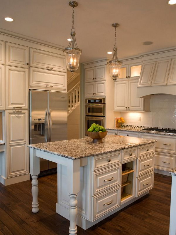Cottage White Island. This marble island is fitting the kitchen very much. Love the doors and the marble. Also love the beautiful classic white cabinets.