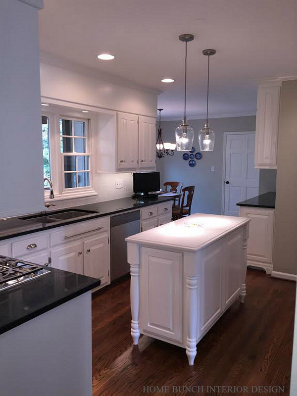 Small white traditional kitchen. The island was beautifully made and looks very elegant. The integrated island feet add a traditional feel to this piece. The island paint color is also Benjamin Moore OC-17 White Dove.