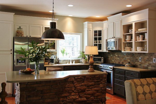 Both functional  and glamorous. In this white kitchen, the rustic stone island was made in a crazy shape. And the designer decided to put stools around it. Love the white cabinets and the light fixture.
