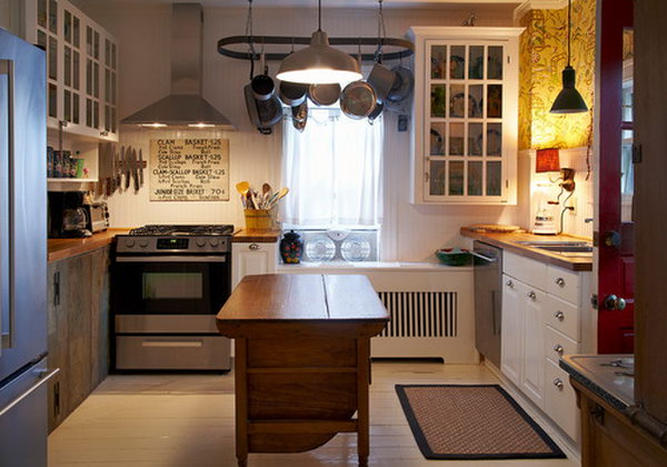 Small antique island. This adorable kitchen looks attractive for its simplicity and neat feeling which is casual and inviting.Look at the woods, the white, the lighting and the old dresser island.  It has an eclectic mix of vintage, industrial and rustic that works.