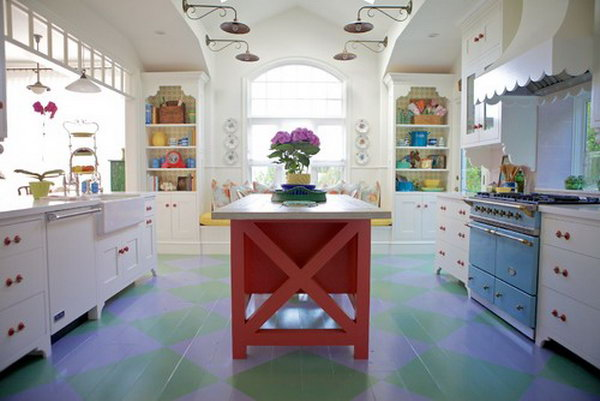 Coral-colored island. This chic cottage kitchen is really a different one. Every detail is  elaborately made. White kitchen, painted wood floor, red island, blue range...beautiful!