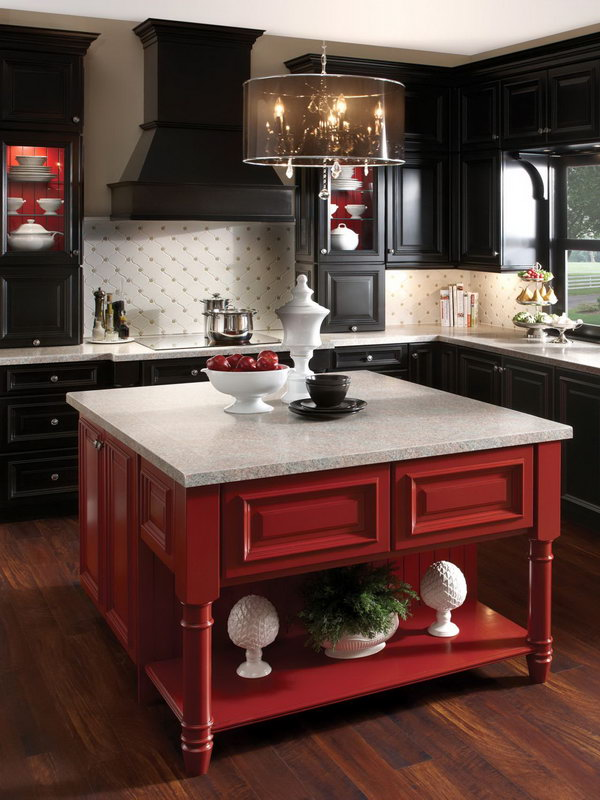 Black with a Pop of Red. Black cabinetry has been so hot, but  so much black can feel heavy and dark. Buoy it with a shot of brilliant color, such as the red on this kitchen island.
