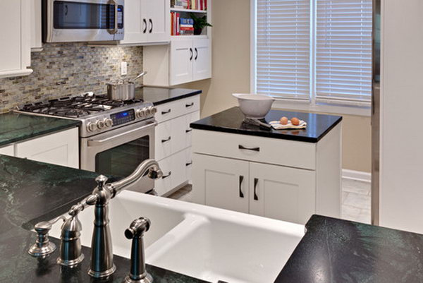 Black and white compact kitchen island. In this small kitchen, an extra island is worthy for the storage and prep space.  And it also adds to stylish feeling. Love it.