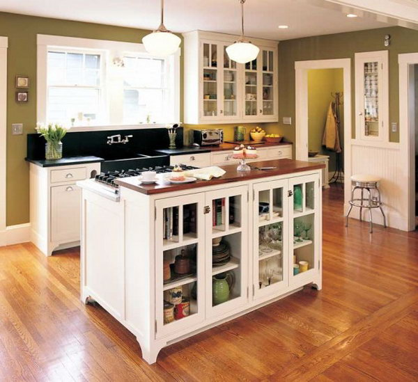 Island combines stove and storage.This custom-made movable kitchen island with plate rack and stove not only offer original storage strategies, but also offer a convenient display opportunity and keep the room from feeling confined.