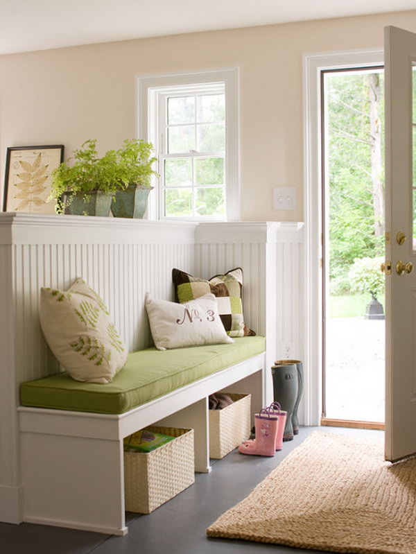 Bright and cozy.  What a fresh, comfortable, and inviting mudroom. Green plants and green bench ecco green trees outdoor. Love the  white wood work.  Really clever room seperation which adds extra function and makes the small space look larger. A neat way to make a foyer.