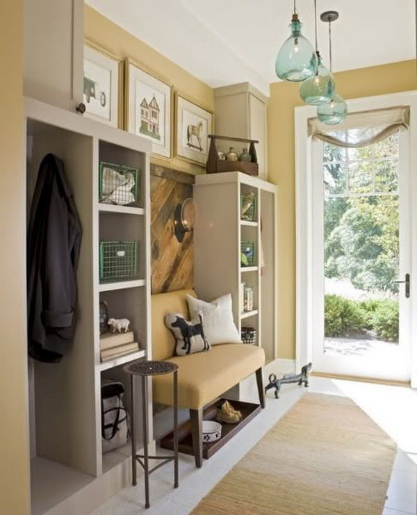 Neutral color mudroom. This yellow mudroom is too pretty to be a 'mud room'. The layout of color is perfect and gives the space a warm and cozy look. All the details are inspiring. And it has great storage space.