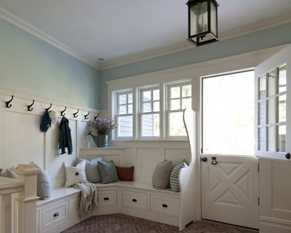 Soft blue and white. If you want a fresh and clean look to go with your mudroom. This one is a great inspiring. Every detail of this mudroom is perfectly organized including the tiles, benches, drawers, the dutch door, windows, hooks, lantern...and everything.