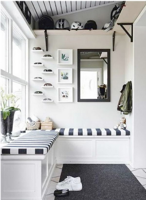 Black and white mud room. The contrast between white and black is so beautiful and applied to interior design for a long time. This mudroom is a great example. I'm in loving with the striped beach-style cushions and L shaped bench, lots of light, nook.