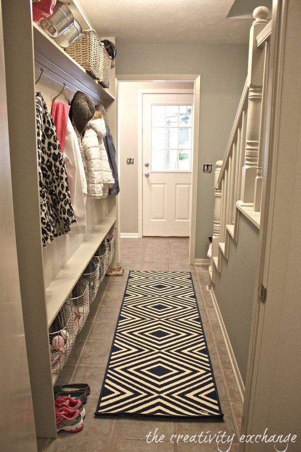 Extra place. If you are looking for a idea for changing your narrow small hallway to a functional mudroom, this would be a great inspiration. Look at the color shades, the rug,  baskets on the bottom to put stuff in, the panel of beadboard to make the surface durable, the hooks to hang up your coats and purses. And this creative idea is easy to diy on budget.