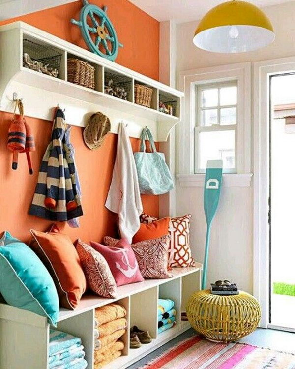 Fantastic colorful mudroom.  Love the bright color palette, orange, yellow, green, white.  Simply beautiful details through out! Great for the kids.