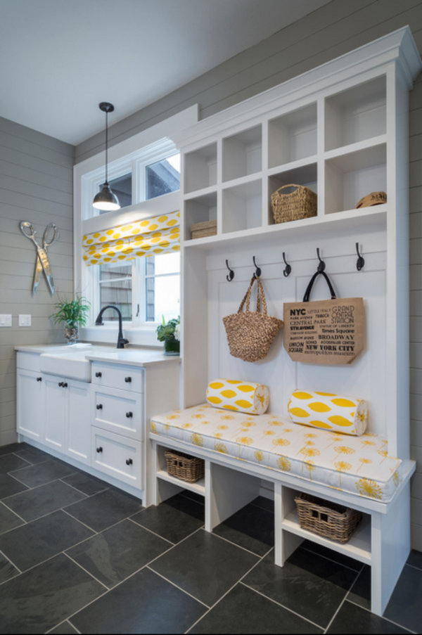 Fresh look. This charming mudroom is done to perfection!  Lovely yellow cloth decor infuses fresh feeling to this white and green mudroom. Especially love the sink, which can keep the mud out from dirtying up the rest of the house.