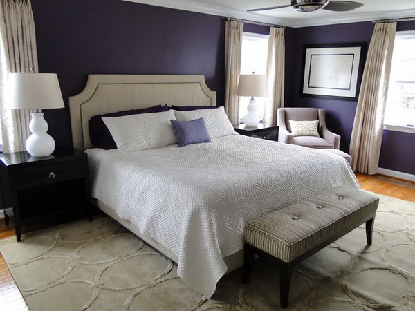 Purple-blue and White Deco Bedroom: I love how they pair plethora of dark purple with warm neutrals and light for some contrast. The black furniture  really pops the white lamps and other items around it.