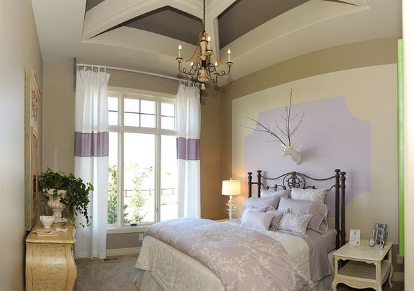 Create an Illusion: In a bedroom without large floor-to-ceiling windows, here's an example of how you can introduce your favorite purple in and make the space visually spread. I love the way nature touches the room in modern, and the whimsical ways with the lamp, and the deer head.