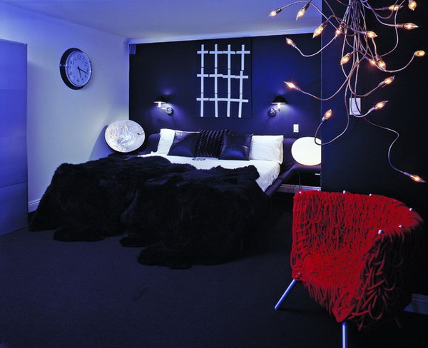 Create Drama: In this deep purple bedroom for a 16 yr old boy which could be for any age man, black is used on the bed wall to create drama. Every room should have a 'surprise' or a fabulous peice of furniture.