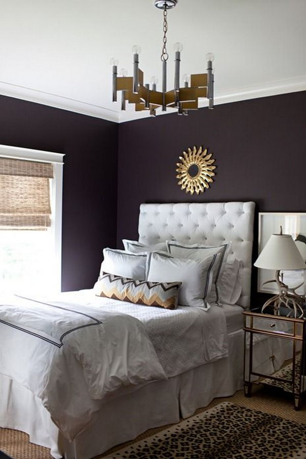 Deep purple wall: The deep color speaks volumes in this simple, yet elegantly-styled room!