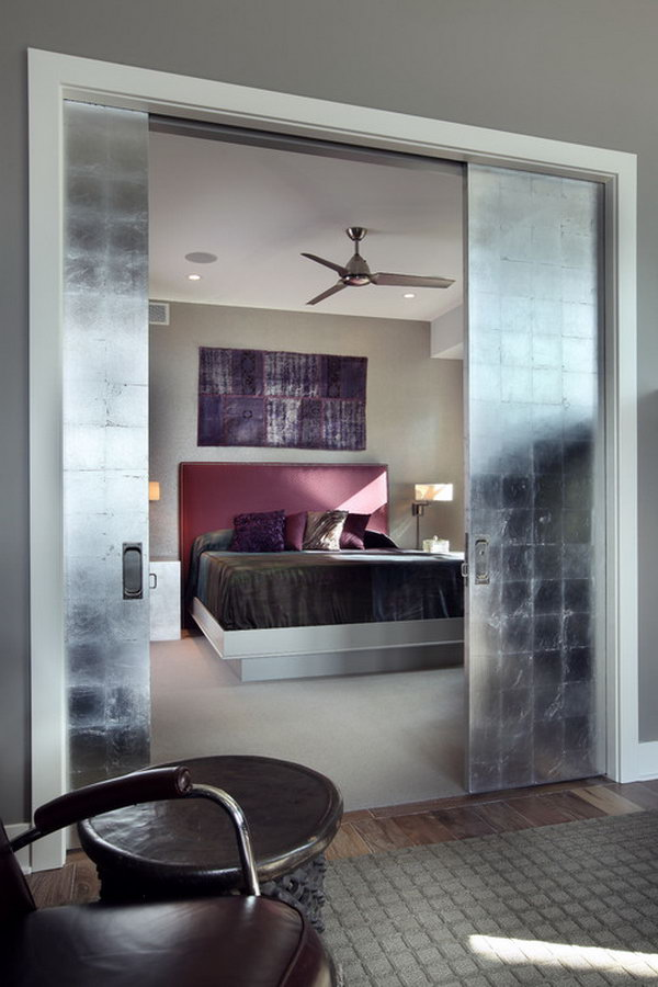 Master Bedroom With Oversized Silver Leaf Pocket Doors