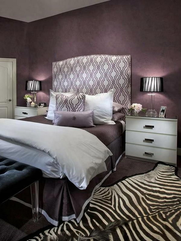 Headboard and Zebra Rug Accents: This bedroom oozes glamour with its mix of purple hues and the beautiful headboard and the eye-catching zebra rug.