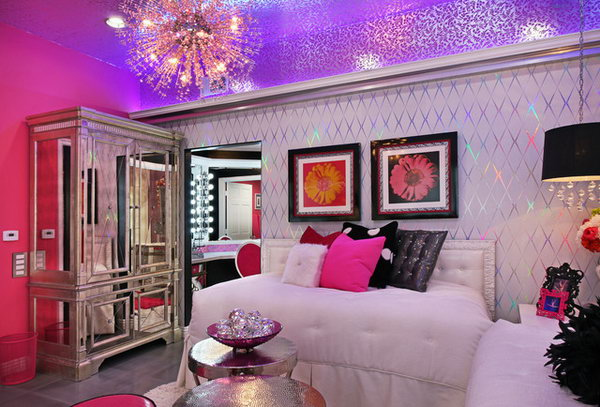 Shining Ceiling: The bright sparkly foil wall paper on walls with pink walls and the mirrored and shiny armoire are gorgeous. The shining silver leaf ceiling and the splashy pink crystal light fixtures work well together, add interest, and make this already glamorous setup even more scintillating.