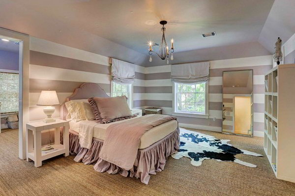 Purple and White Striped Bedroom: With the soft color seagrass carpets and chandelier, the purple and white striped bedroom looks both shabby chic and cool.