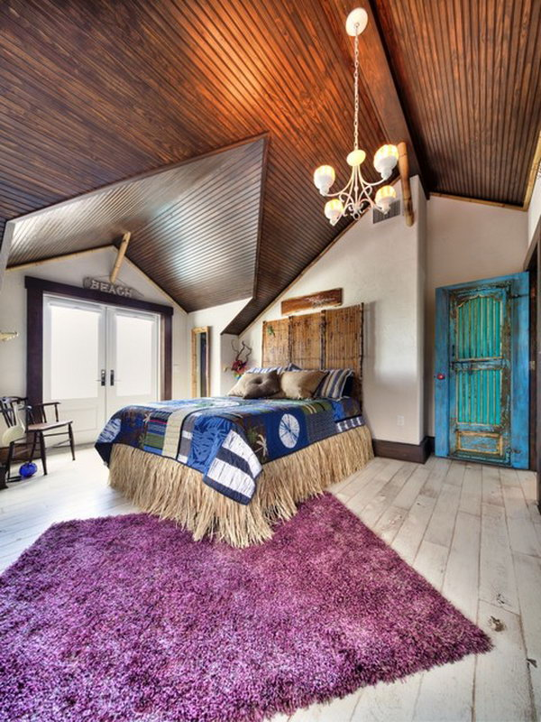Purple Rug: In this spectacular eclectic master bedroom, the ceiling, the fuschia, turquoise, browns and tans all pair so well with one another! Love the door, rug, ceiling and the room layout!