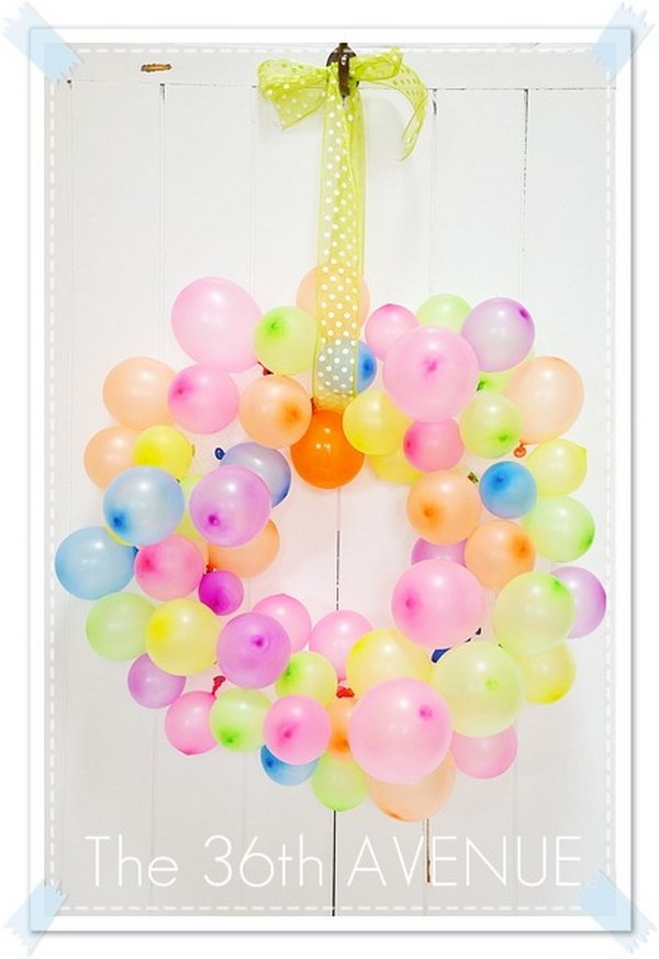 Summer Balloon Wreath. Every kid loves balloons. You can get this idea for your little ones to make a beautiful balloon wreath during the summer.